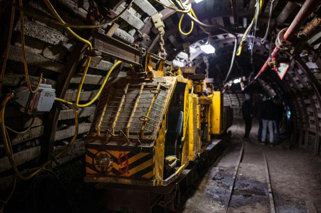 Underground train in black coal mine tunnel. Silesia, Poland